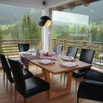 Dining table in front of the panoramic windows
