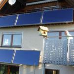 Walddorf: Solarkollektoren Balkon / Fassade
