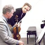With violinist Gregory Ellis. Photo by Eddie Weij