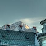 Stimmung wie aus dem Bilderbuch: Dach der Hofburg und verschneite Berge