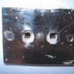 Façade métallique et alvéoles protégées par de la porcelaine