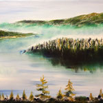 Fog over mountain lake