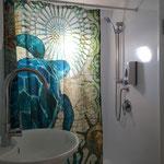 Die Badezimmer laden ein zum entspannten duschen nach dem Tauchgang.