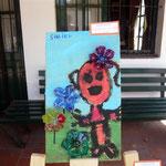 27 Shaiel Maciel- Nena con flores- madera