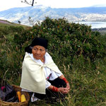 Indigenous infront of Lago San Pablo panorama.