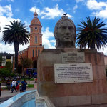 The monument of the Inca General Rumiñahui, who led a rebellion against the Spanish conquerors in the 16th century. In the background the church of San Luis.