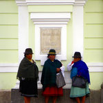 Indigenous women from Cayambe (Cayambeños) in front of the municipio of Otavalo.