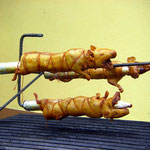 Cuy on a spit (guinea pig).