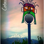 The snow-capped volcano Cotacachi (4.935m). In the foreground one of the beautiful street lamps in Otavalo.