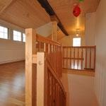 Holztreppe und Galerie bei einem Umbau