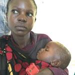 Junge Patientin mit ihrem Kind