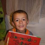 Timéo a rapporté un dossier avec son travail de la matinée et une photo de sa classe