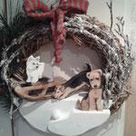 winterlicher Türkranz mit Hunden nach Foto