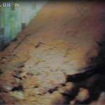 Tube corrodé en  fond de puits