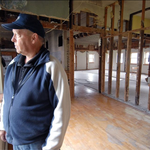Kit Karsten stands inside the old New Groningen schoolhouse, which served as a private residence from 1951 to 2006