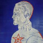Vogeler in Russland    2012, Holzschnitt Das Bild stellt Vogeler unter dem Kommunismus dar. Im Hintergrund befinden sich Hammer und Sichel sowie futuristische Architektur. Der Holzschnitt ist mit zwei Platten in blau und silber gedruckt.
