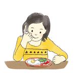 子どもが朝ごはんを食べているイラスト