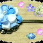 これは、つまみ細工の紫陽花のピンです、ワンポイントで使うと可愛いです、浴衣にもあいますね。