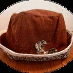 これは茶色のネップツィードに内布は黒の小花のコーディロイで作った帽子、共布のコサージュも付けました。