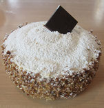 """recette du gâteau """"succès"""" Lenôtre . Meringue amandes , crème au beurre et pralin"""
