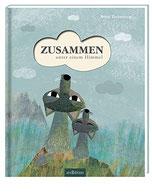 Auf dem Cover sieht man zwei herzig illustrierte Wölfe in den Himmel sehen.