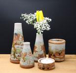 Vasen und Dosen