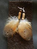 boucles en plumes de chouette