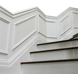 Dramatic Wainscoting up Angled Staircase
