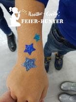 Was funkelt denn da zwischen Köln und Aachen? Kinderunterhaltung mit Glitzer-Tattoos erfreut sich immer größerer Beliebtheit.
