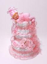 Нежно розовый торт из памперсов с кружевными пинетками и спящим младенцем- роскошный подарок новорожденному ребёнку