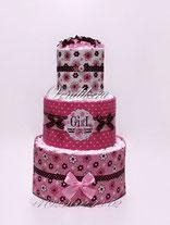 Стильный торт из памперсов с пелёнками для девочки розово-шоколадный