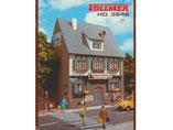 Wohnhaus mit Durchfahrt, Schuhmacherei, Plastik-Modellbausatz der Firma Vollmer, 3646