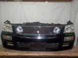 На Ниссан Стейджия Stagea C34 рестайл, 1998-2001 г.в. - передняя часть (ноускат) автомобиля в поздней версии с ксеноновыми фарами, оригинал, б/у.
