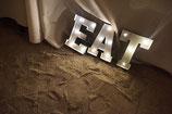 Leuchtbuchstaben EAT, metall