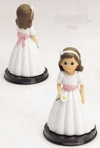 Figura para tarta comunion.  Niña traje con cinta rosa y margarita. 1700. Aprox 16 cm alto