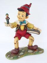 Réplica de Pinocho con el grillo y un libro | Figuras de Pinocho