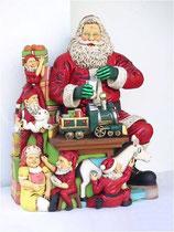 Figura de Papá Noel con regalos y rodeado de elfos para decoración de navidad