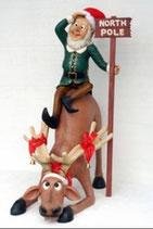 Réplica de elfo montado en un reno para decoración de navidad