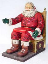 Réplica de Papa noel sentado en su trono para decoración de navidad