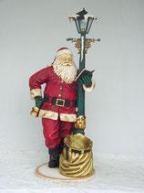 Figura de Papa Noel junto a una farola y leyendo para decoración de navidad