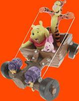 Figura de Winnie y sus amigos montados en un vehículo | Figuras de Winnie