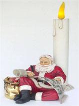 Figura de Papa noel sentado en una vela | Decoración navideña