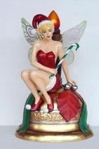Réplica de hada navideña sentada en una campana para decoración de navidad