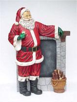 Figura de Papa noel frente a la chimenea ideal para decoración de navidad