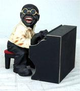 Figura de pianista de jazz tocando su piano | Figuras de jazz