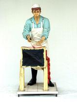 Réplica de carnicero cortando carne | Figuras de carniceros
