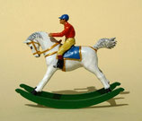 Jockey auf Schaukelpferd