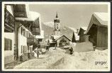 AK Garmisch, die Sonnenstraße mit Kirche im Winter    77b