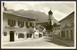 Ak Oberammergau Dorfstraße mit Kirche   14/31