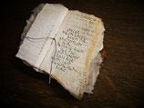 Holzobjekt mit Text